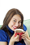 Coffee and a smile. Pretty Asian Hispanic Women enjoying her morning cup of coffee with a big smile on her face Royalty Free Stock Photo