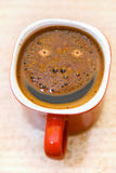 Coffee with smiley face Stock Photos