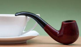 Coffee and smoking pipe Royalty Free Stock Image
