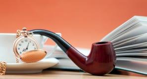 Coffee and smoking pipe Stock Image