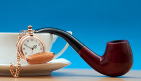 Coffee and smoking pipe Stock Photos