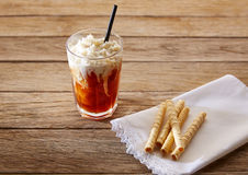 Coffee smoothie with wafers on vintage   table Royalty Free Stock Photography