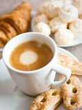 Coffee and snacks. Breakfast composition with cup of coffee, croissant, cookies, kisses Stock Image