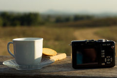 Coffee with snacks meadows as a backdrop, Place the camera with. A coffee cup stock photos