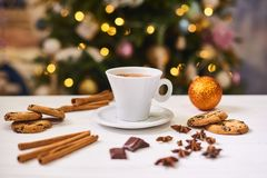Coffee and snacks on the table on new year table. Coffee and cookies on the  white table on the New Year with garland lights  on background Stock Image