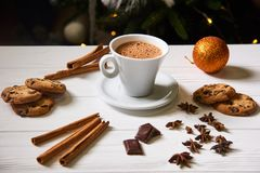 Coffee and snacks on the table on new year table. Coffee and cookies on the  white table on the New Year with garland lights  on background Stock Images