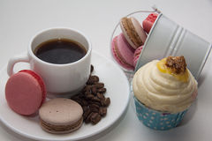 Coffee and snacks under contrast lightning Royalty Free Stock Photography