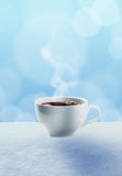 Coffee in the snow Royalty Free Stock Image
