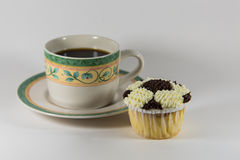 Coffee and soccer ball cupcake. A cup of coffee and soccer ball cupcake Royalty Free Stock Photo
