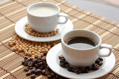 Coffee and Soya. (with beans) On a wooden background Royalty Free Stock Image