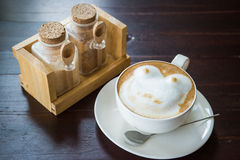 Coffee with spice and artistic foam in a white cup Royalty Free Stock Photo