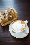 Coffee with spice and artistic foam in a white cup Stock Photo