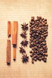 Coffee spices on old craft vintage paper background stock photography