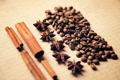 Coffee spices on old craft vintage paper background. Cinnamon, star anise and coffee beans placer horizontal photo royalty free stock photography