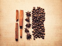 Coffee spices on old craft vintage paper background horizontal photo stock photos