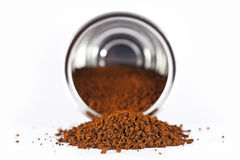 Coffee spilled from the can Stock Images