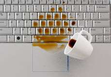 Coffee spilled on keyboard Royalty Free Stock Image