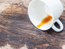 Coffee spilled out from white cup Stock Photography