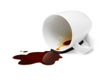 Coffee spilling. Cup of black coffee spilling causing stained stock images