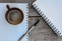 Coffee and spiral notebook Royalty Free Stock Images