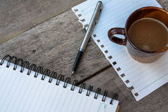 Coffee and spiral notebook Stock Images