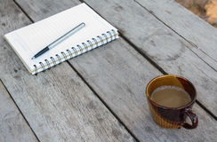 Coffee and spiral notebook Royalty Free Stock Photos