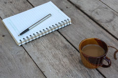 Coffee and spiral notebook Royalty Free Stock Photography