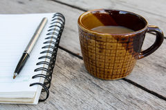 Coffee and spiral notebook Stock Photography
