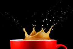 Coffee splash. Cup of coffee with a crown like splash stock images