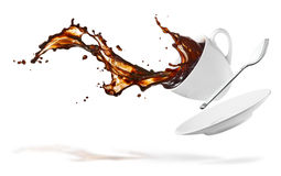 Coffee splash. Cup of spilling coffee creating splash Stock Photos