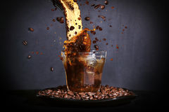 Coffee Splash. Coffee being poured into a glass. Royalty Free Stock Photos