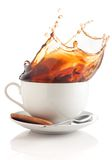 Coffee splash in a cup Royalty Free Stock Images