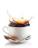 Coffee splash in a cup Stock Photo