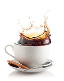 Coffee splash in a cup. Isolated on white Stock Photography