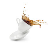 Coffee splash from a cup with plate Royalty Free Stock Image
