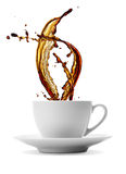 Coffee splash. Cup of splashing black coffee isolated on white stock photos