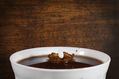 Coffee with splash of milk Royalty Free Stock Image