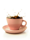 Coffee splash in pink cup Stock Photos
