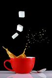 Coffee splash with sugar cubes. Cup of coffee with a splash, caused by a sugar cube royalty free stock images