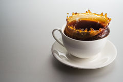 Coffee splash Stock Photography