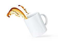 Coffee splash in white cup isolated on white background. File contains a path to isolation. Stock Photography