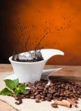 Coffee splashes Stock Photos