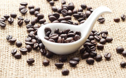 Coffee in spoon and sack background Stock Images