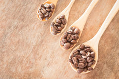 Coffee spoons on grunge wooden table Stock Photography