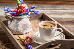 Coffee and spring flowers for breakfast Royalty Free Stock Photography
