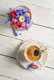 Coffee and spring flowers on old white table Stock Photography