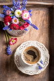 Coffee and spring flowers on old wooden tray Royalty Free Stock Photo
