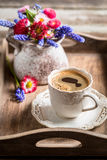 Coffee and spring flowers on wooden tray Royalty Free Stock Photos