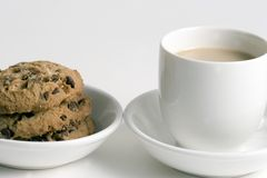 Coffee and Stack of Chocolate Chips cookies. On white plate isolated on white background royalty free stock images