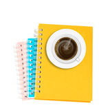 Coffee on stack of ring binder book or notebook isolated on whit Royalty Free Stock Image